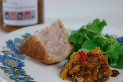 vintage plate with a slice of pork pie, pea shoots and dollop of home made spiced apple chutney