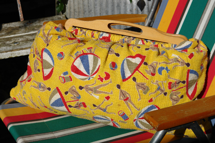 vintage beach bag made of bright yellow 1950s towelling fabric with beach umbrella and male & female swim-suited figures pattern