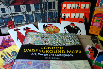 """London Underground Maps - Art, Design and Cartography"" by Louise Dobbin with a selection of vintage London items such as Kenneth Townsend tiles and London bus jigsaw"