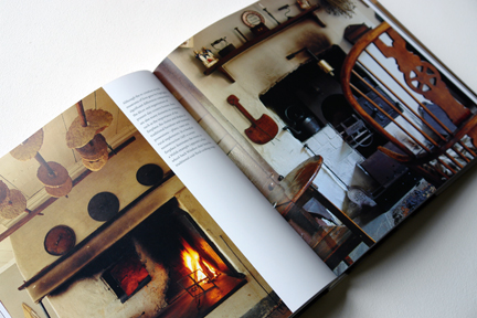 "double page spread showing an open fire with oatcakes drying above and a rustic, antique cast iron stove from ""The Way We Live In the Country"" by Stafford Cliff & Gilles de Chabaneix"