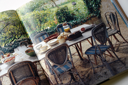 "vintage blue & white bistro chairs on a patio from ""The Way We Live In the Country"" by Stafford Cliff & Gilles de Chabaneix"