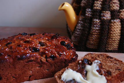 malt loaf made from Paul Hollywood's recipe with yellow, cosy covered yellow teapot