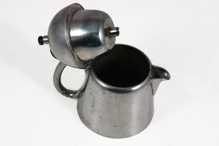 detail from vintage industrial designed steel coffee percolator