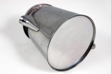 detail from vintage industrial designed steel coffee percolator