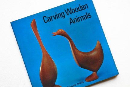 cover of a vintage craft booklet showing carved wooden animals
