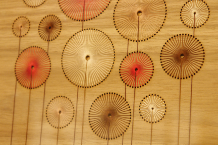 detail from a handmade bent plywood and threaded cotton lampshade by Jane Blease Design who exhibited at Great Northern Contemporary Craft Fair 2010
