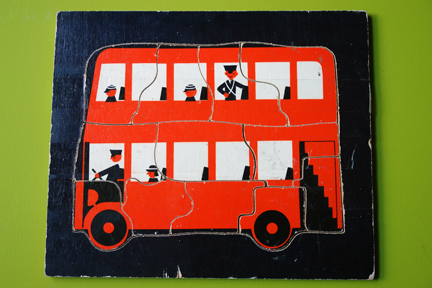 vintage children's jigsaw of a red London double decker bus