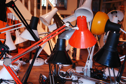 multicoloured collection of vintage anglepoise lamps