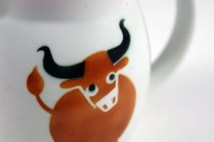 detail from a vintage Arabia milk jug with cow design
