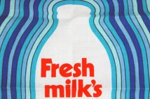 detail from a vintage milk bottle teatowel