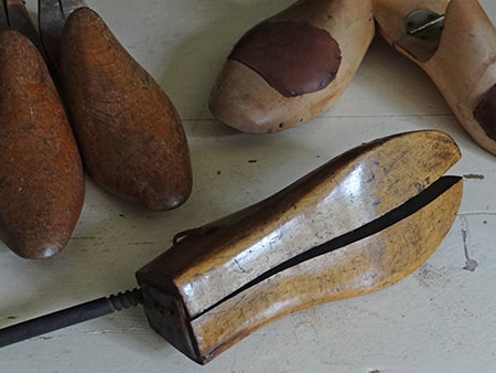 three pairs of vintage wooden shoe lasts