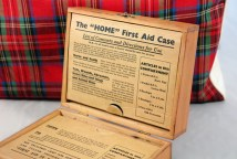vintage wooden first aid box with lid open showing contents