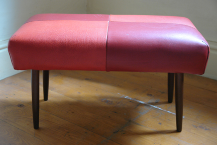 vintage 1950s footstool with red vinyl seat