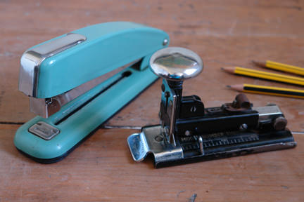 pair of vintage staplers