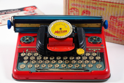 vintage 1950s red tin Mettype typewriter