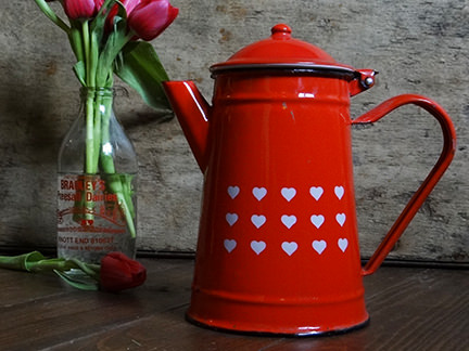vintage red enamel coffee jugdecorated with little white hearts