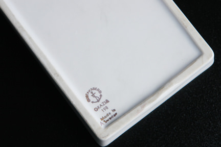 "detail showing the backstamp from a small white vintage Gustavsberg ""Grazia"" pin dish designed by Stig Lindberg"