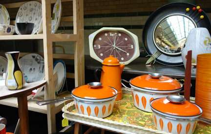 collection of orange vintage Cathrineholm Lotus enamel saucepans