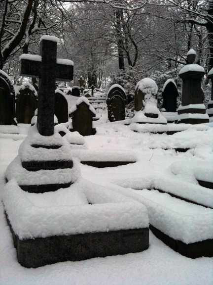 snow-covered gravestones in Todmorden Unitarian churchyard