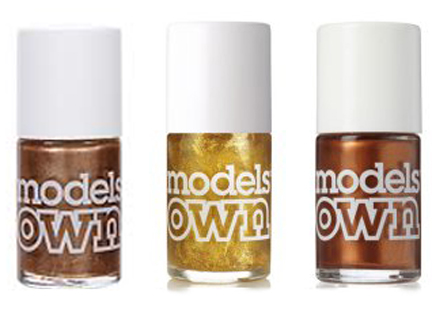trio of Models Own nail polish bottles in metallic colours
