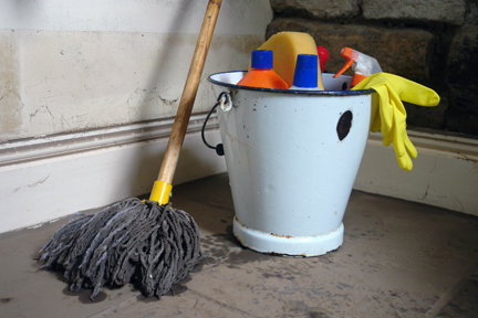Mop, bucket and cleaning materials in the downstairs cloakroom the morning after the flooding