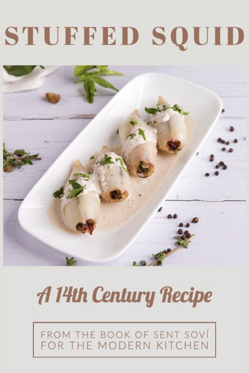 stuffed squid from the book of sent sovi. squid are set on a single layer on a plate, covered in almond sauce and sprinkled with parsley. the place is placed on a white wooded surface.