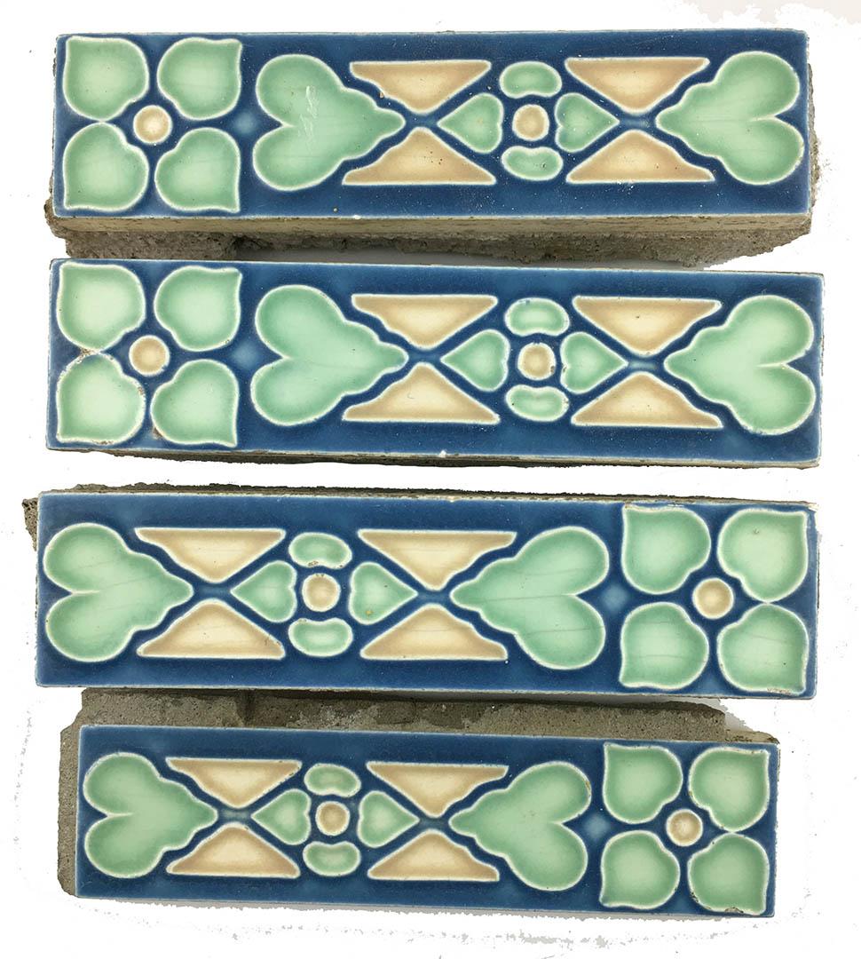 antique set of 4 border trim tiles in blue green yellow geometric pattern