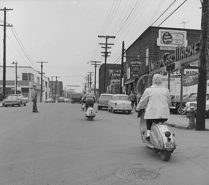 """From the series """"Meter Maids"""" (1960), Ted Grant captures some of the action at Bank and Clarey in the Glebe. Image: Ted Grant / LAC Accession 1981-181 NPC Series 60-965A, Image 177."""