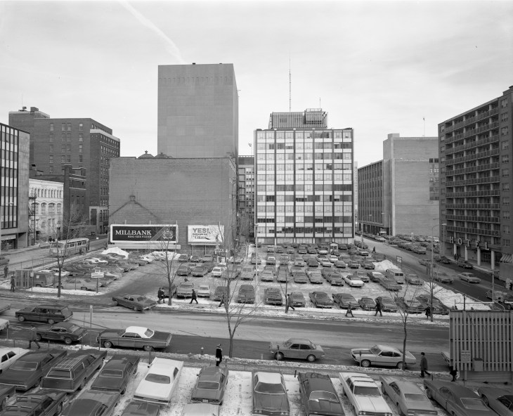 City Parking's L-shaped lot at the corner of Queen and Metcalfe, as it appeared in 1973. Image: Bill Cadzow / CMHC 1973-102, Image 4.