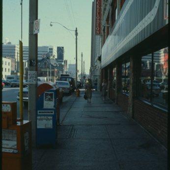 File consists of slides that depict aerials and street scenes of John from Queen to the waterfront and Jarvis street around Dundas.