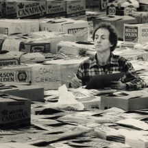 Warehouse manager Barry Davidson tallies the donations in 1987. Image: Bernard Weil / Toronto Star / Toronto Public Library, Baldwin Collection, Item TSPA 0007866f.