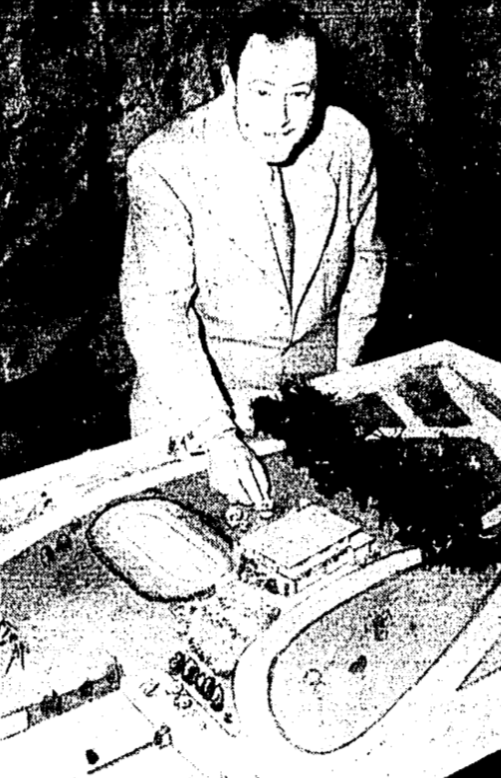 Marshall Foss inspects a model of the Community Centre. Image: Globe and Mail, April 25, 1950, 8.