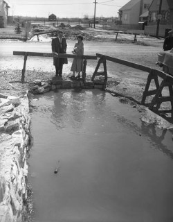 (Near) deadly drainage: in the Spring of 1954 this 20-foot culvert nearly claimed the lives of two. Image: City of Ottawa Archives / Andrews Newton CA003849 April 9, 1954.