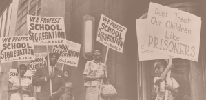 sepia color people walking with signs protesting against school segregation