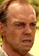 Hugo Weaving as Tom Doss