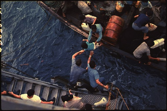 South China Sea. Crewmen of the amphibious cargo ship USS Durham (LKA-114) take Vietnamese refugees aboard a small NARA - 558518 by Unknown or not provided - U.S. National Archives and Records Administration. Licensed under Public Domain via Wikimedia Commons