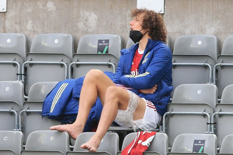 Arsenal's Brazilian defender David Luiz sits on the sidelines watching during the English Premier League soccer match between Newcastle United and Arsenal at St James' Park in Newcastle-upon-Tyne, northeast England, on 2 May 2021. - RESTRICTED TO EDITORIAL USE.  Not for use with audio, video, data, match lists, club / league logos, or services