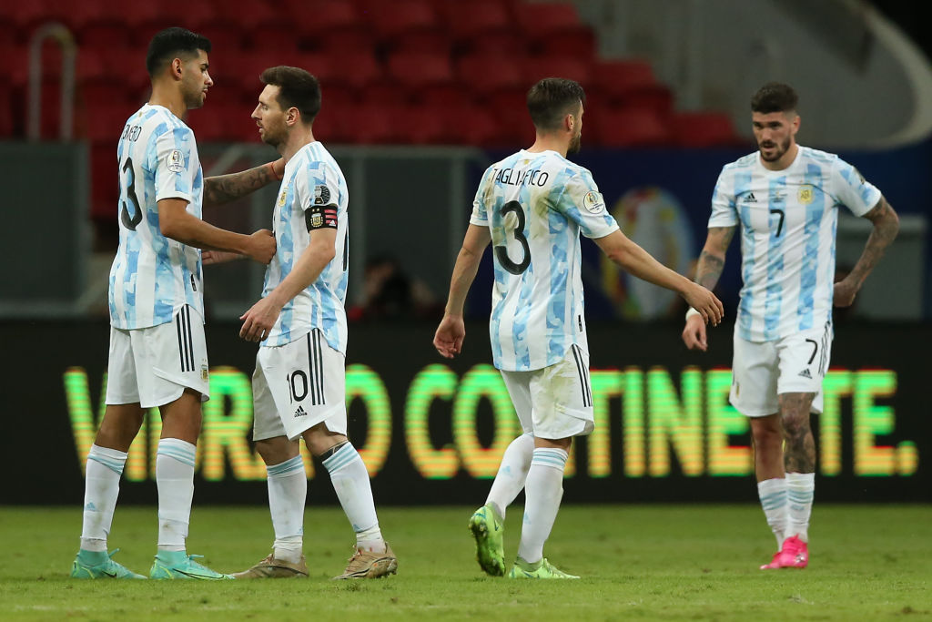 BRASILIA, BRAZIL - JUNE 21: Lionel Messi of Argentina celebrates with teammates Cristian Romero, Nicolas Tagliafico and Rodrigo De Paul after winning a group A match between Argentina and Paraguay as part of Conmebol Copa America Brazil 2021 at Mane Garrincha Stadium on June 21, 2021 in Brasilia, Brazil. (Photo by Alexandre Schneider/Getty Images)