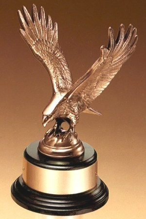 "Antique bronze casted eagle statue on round black base with gold engraving plate, 1295/XL is 9"" tall, weighs 4 lbs."