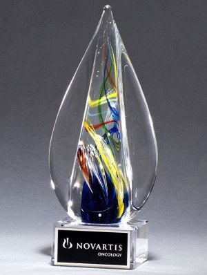 "Pointed spire piece of glass with streaks of color throughout, Mounted on clear glass base, 2261, 7.25"" tall"