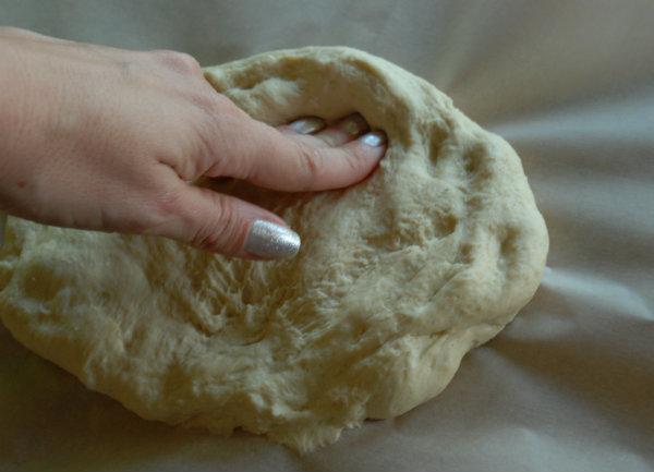 pushing pizza dough