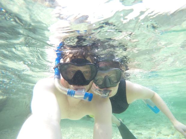 Snorkelling the crystal waters around the Sea Caves