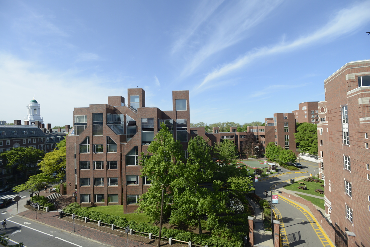 Photo of blue sky and Belfer Building at Harvard Kennedy School