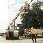 Harris-McBurney installing Cable TV overlead coax