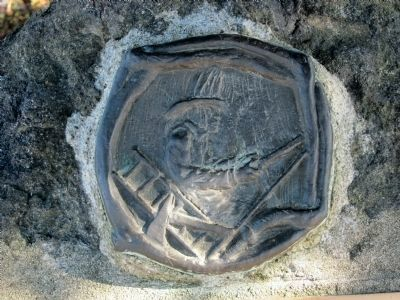 Relief of fireman above the marker Photo, Click for full size