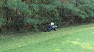 grounds crew mowing grass