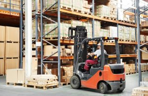 warehousing employee operating a forklift