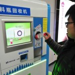 Picture about Passengers at Beijing Subway Cab Pay with Plastic Bottles