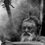 Picture about Indian Man Keeps His Arm Raised for 38 Years in Devotion to Shiva Deity