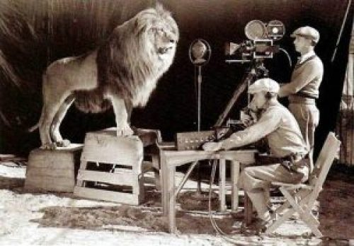 "Picture: Slats, the original ""Leo"" filming the logo sequence in 1924."
